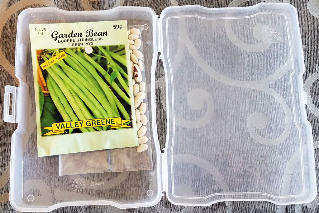 open photo storage box holding green bean seed packet