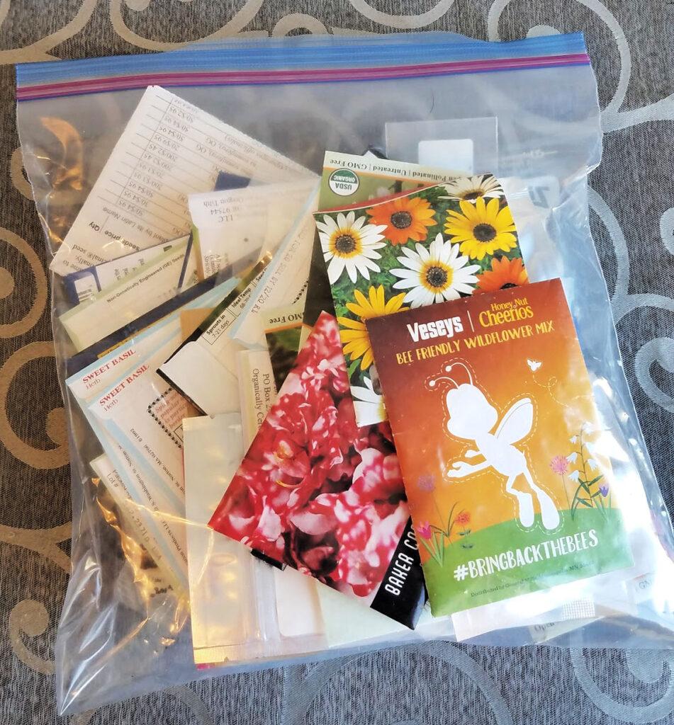 Gallon ziploc bag storing garden seed packets