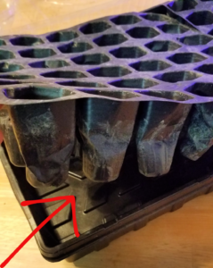 Bottom of seed starting cell tray