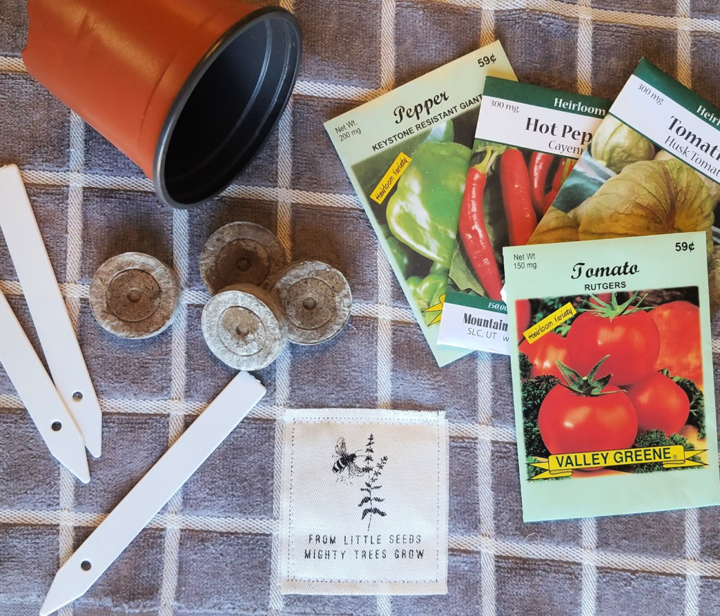 Seed starting supplies on gray towel
