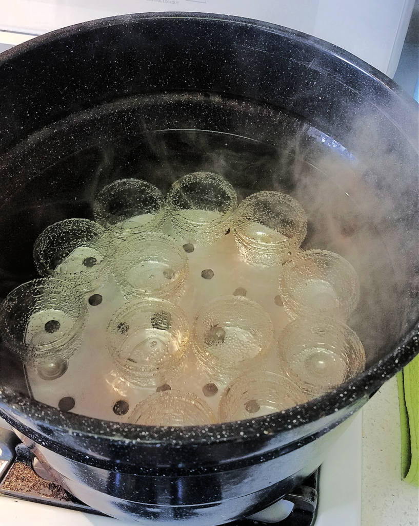 jars warming in canner