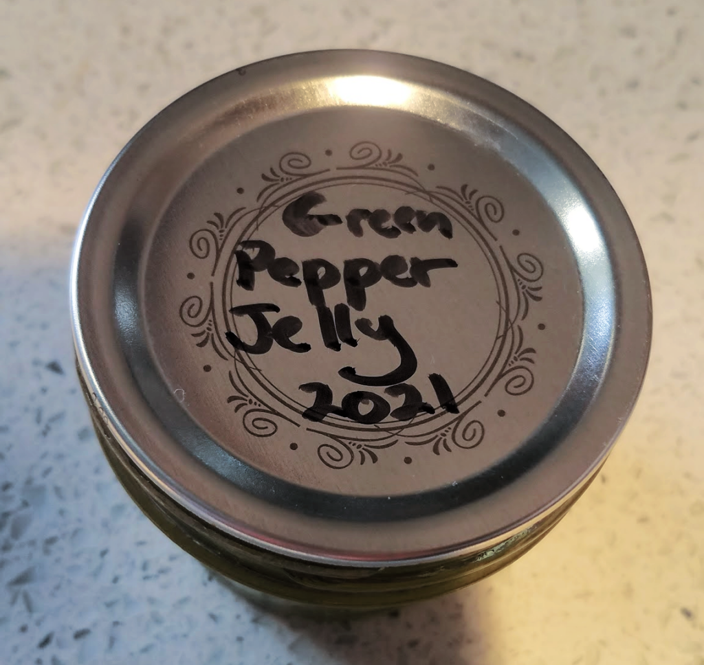 Canning lid labelled green pepper jelly 2021